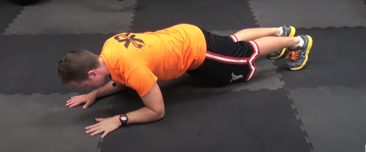 Plank tricep extension